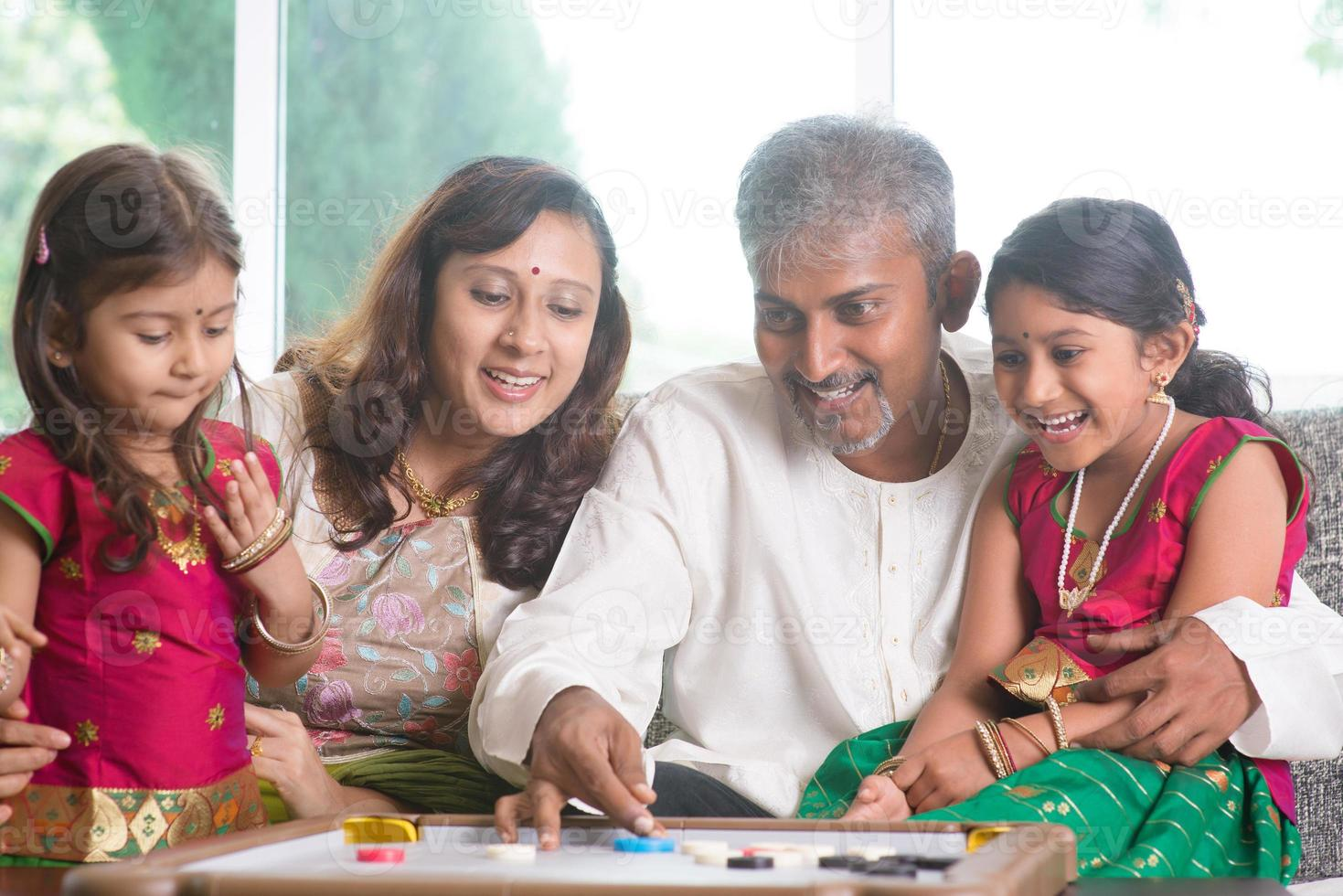 Indian family playing carrom game photo