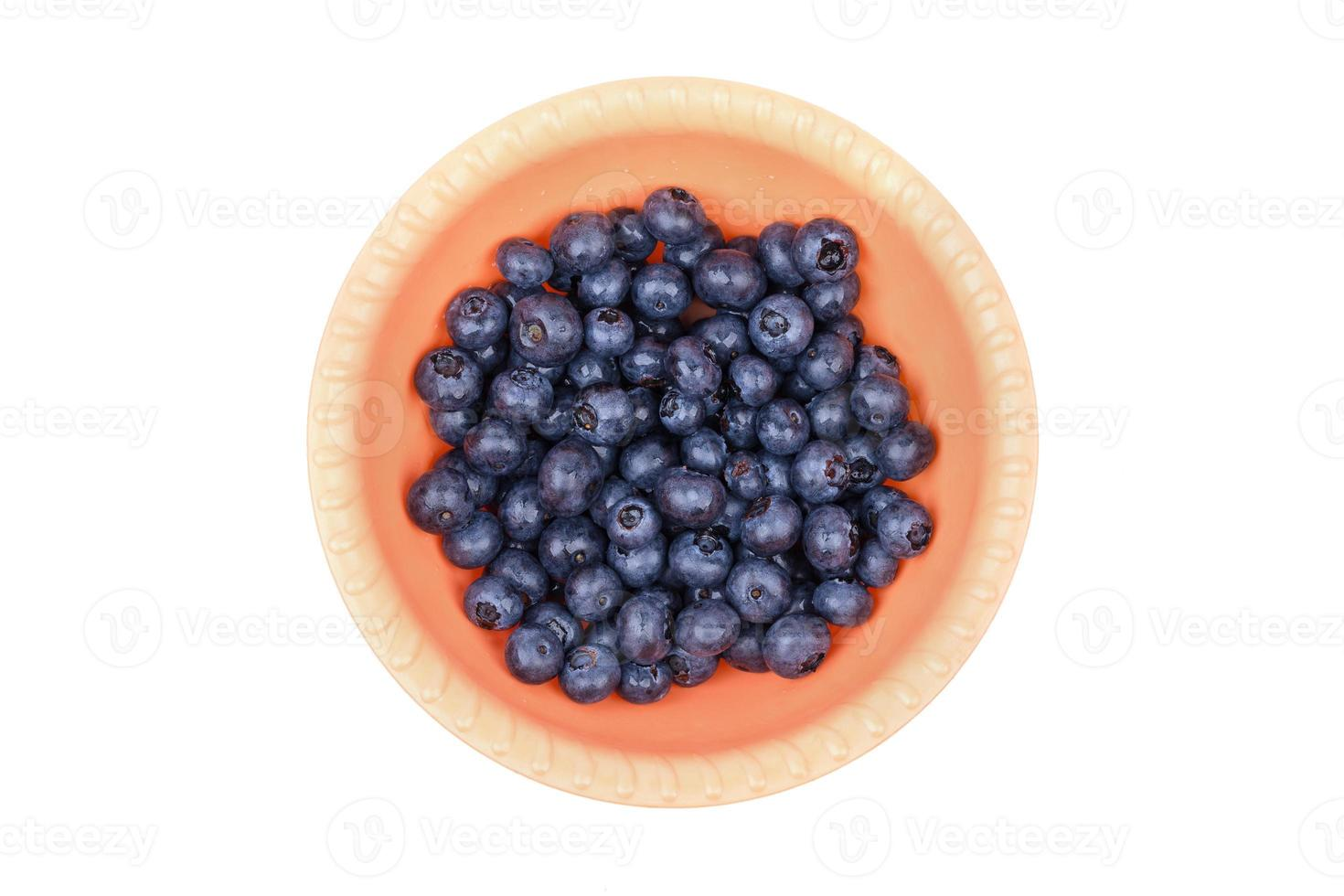 Blueberries in a plastic plate photo