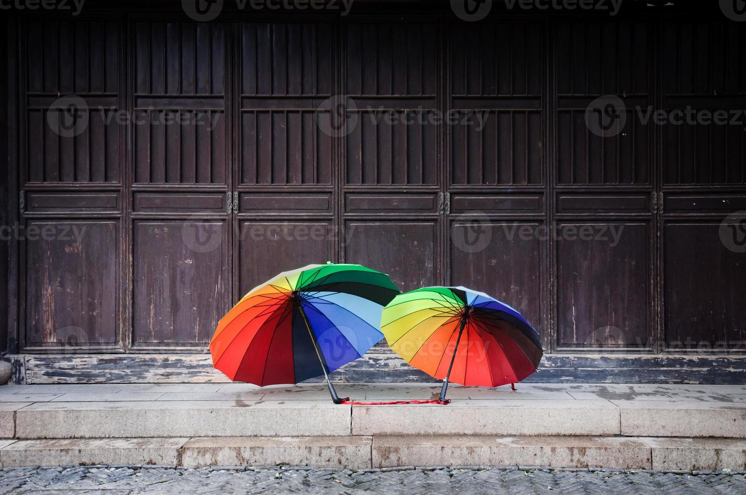Rainbow umbrellas in the old town of Suzhou, China photo