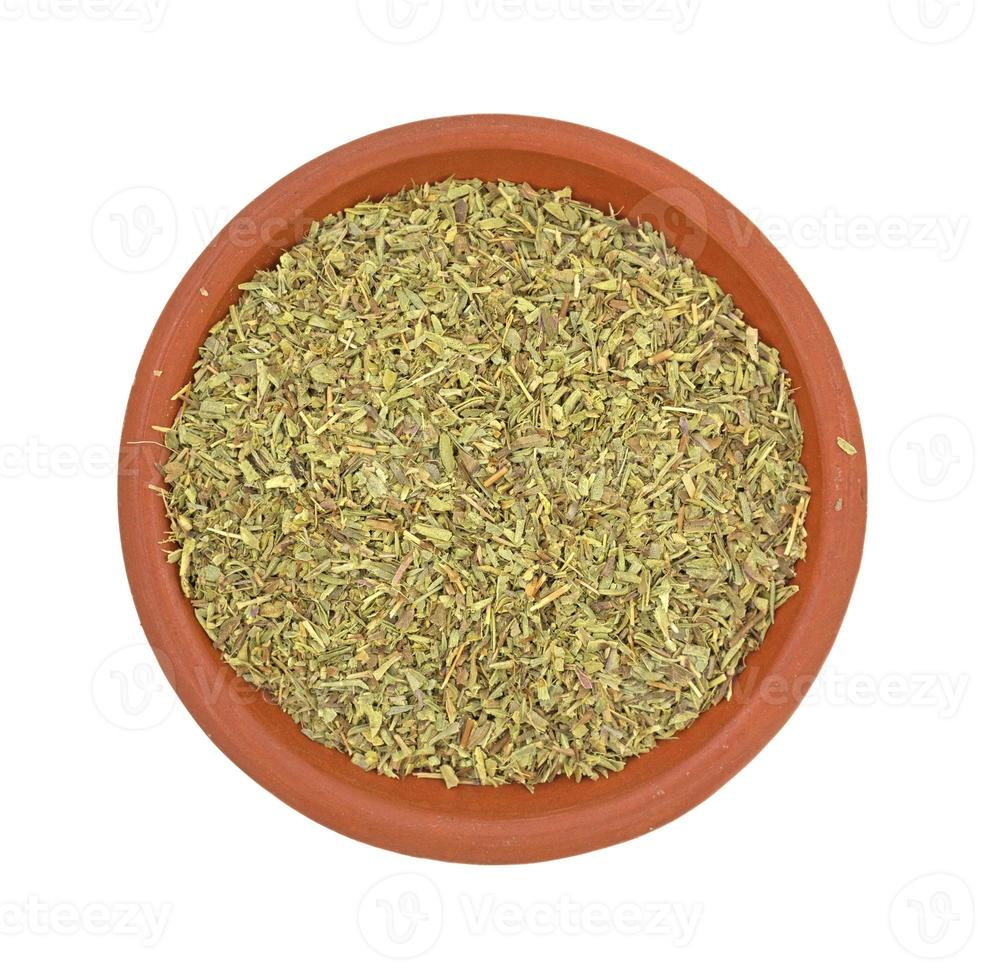 Portion of savory herb in dish photo