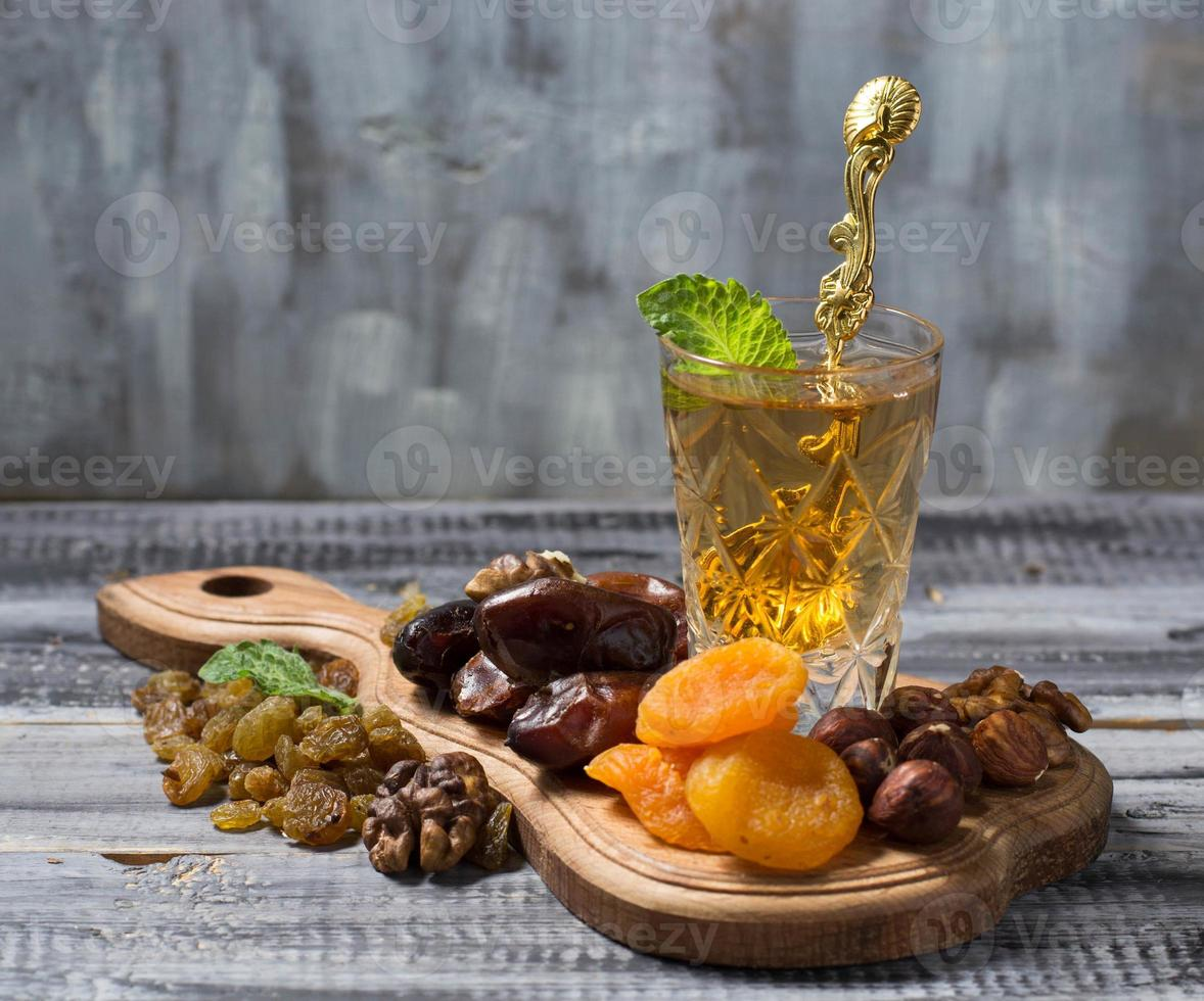 Traditional arabic tea and dry fruits photo