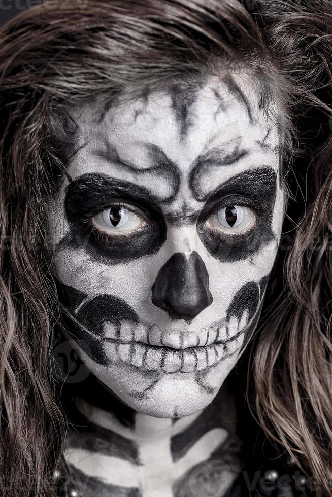 Women painted as skeleton photo