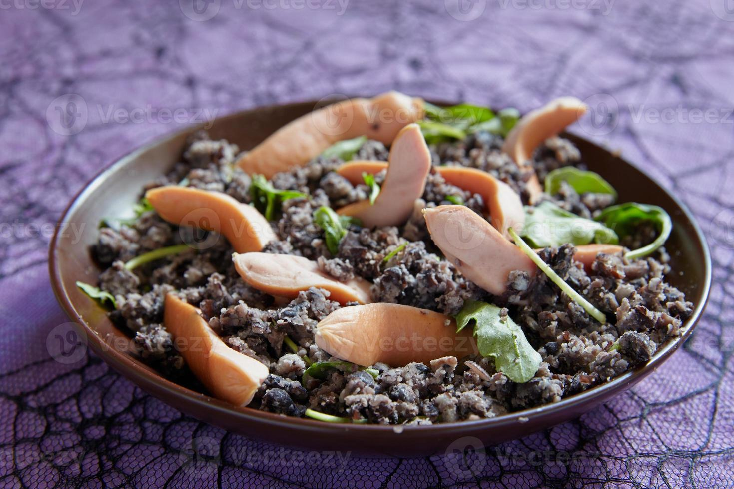 Mashed black beans and sausages photo