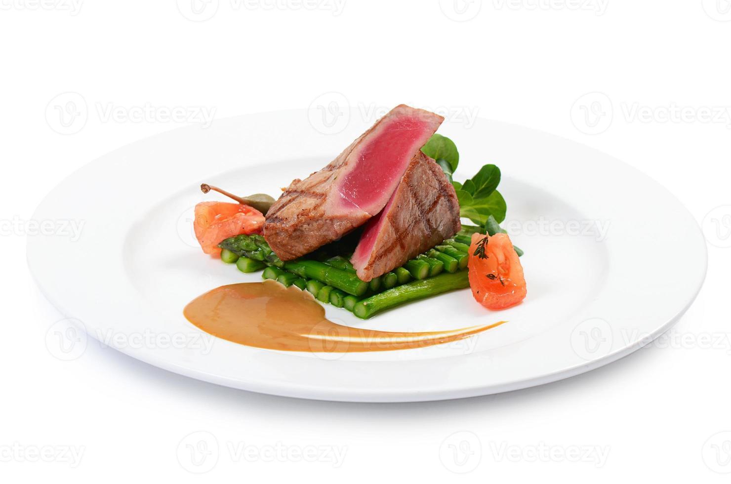 Tuna a grill with an asparagus photo