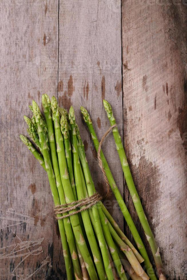 Asparagus on wooden background photo
