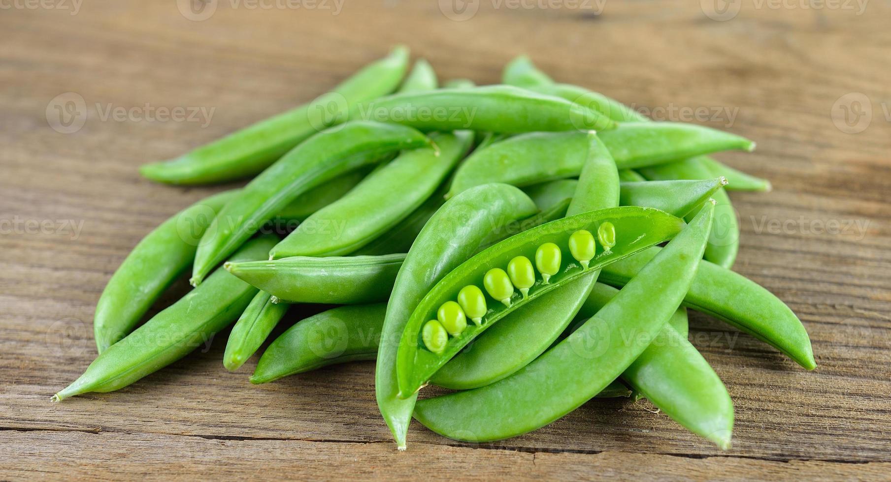 Fresh green beans on wood background photo