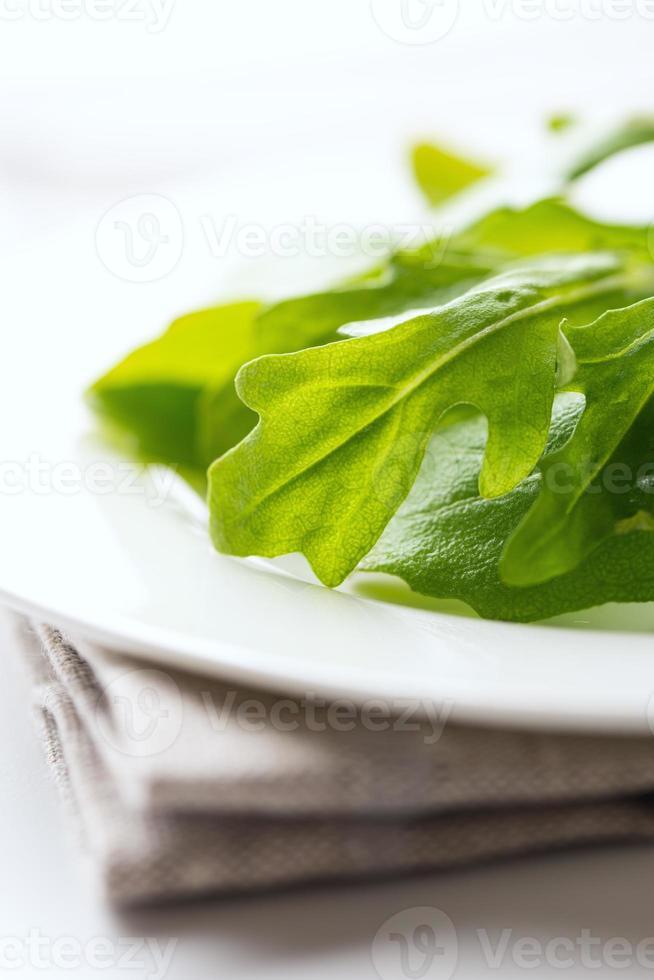 Fresh arugula leaves on napkin photo