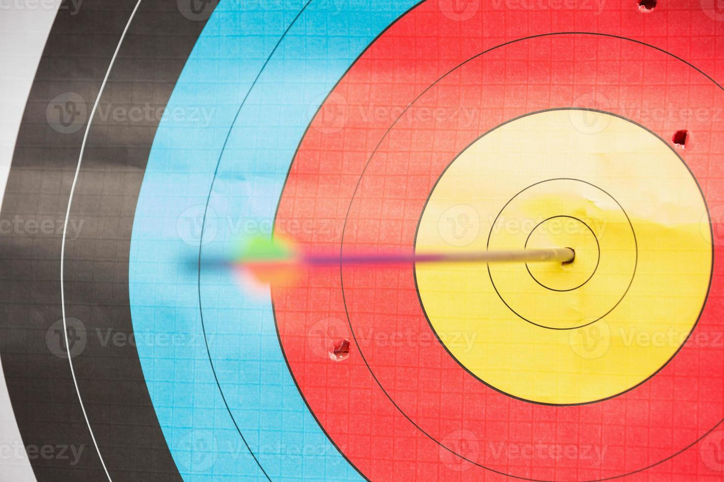 Arrow in bulls eye target photo