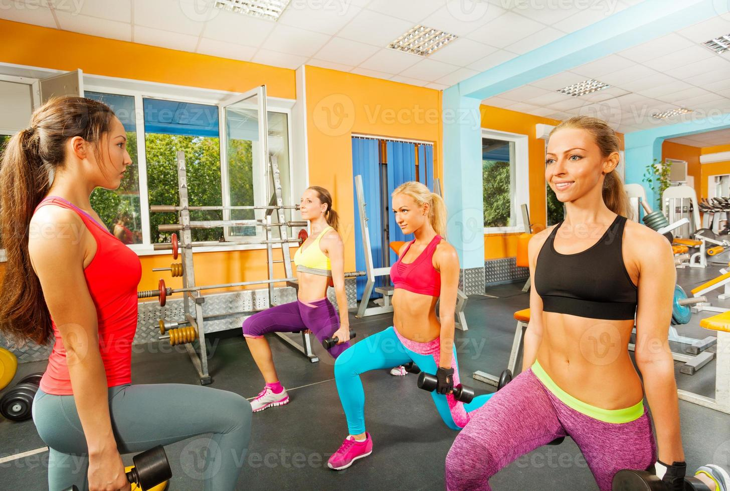 Portrait of girls doing exercises in gym photo
