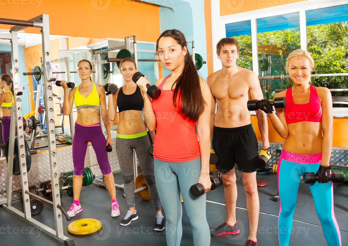 Five nice young people in the fitness club photo