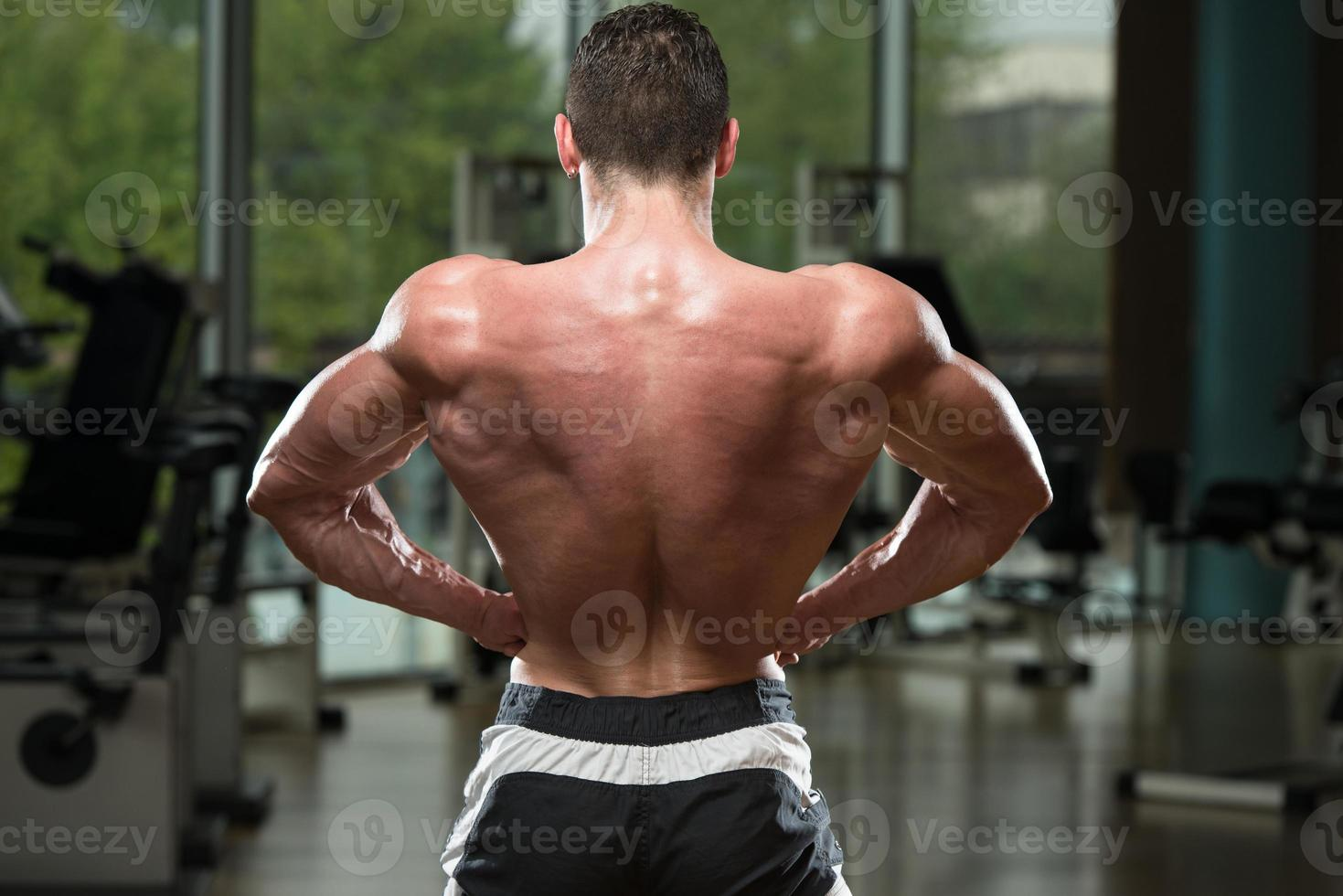 Young Bodybuilder Flexing Muscles photo
