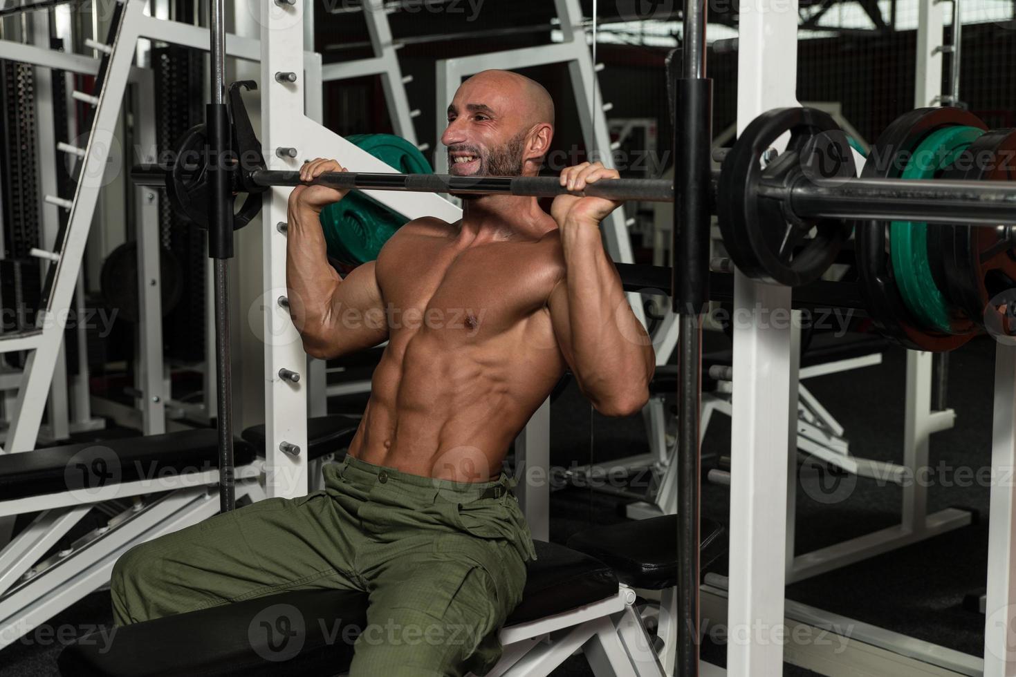 Shoulder Exercises On A Smith Machine photo