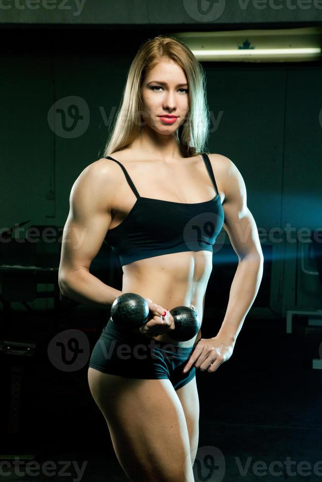 Beautiful sporty muscular woman photo