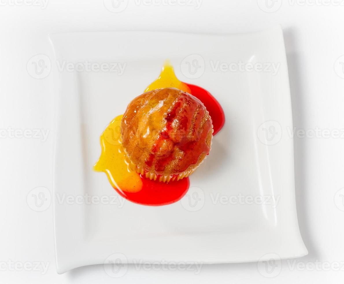 Piece of pineapple cake cream isolated on white photo