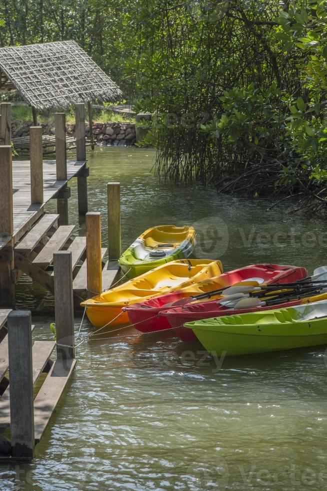Canoes at lake pier, adventure lifestyle concept. photo