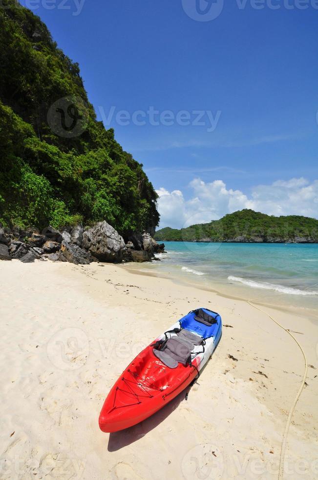 Kayak on the beach at Thailand photo