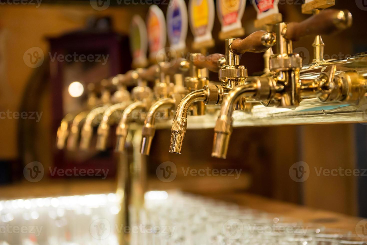 Different beer taps in a row photo