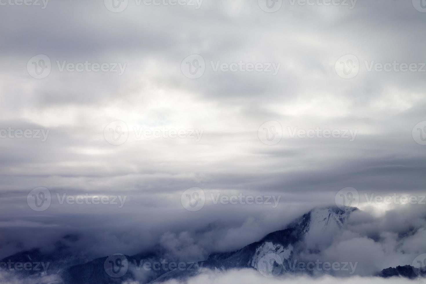 Winter mountains covered with clouds photo