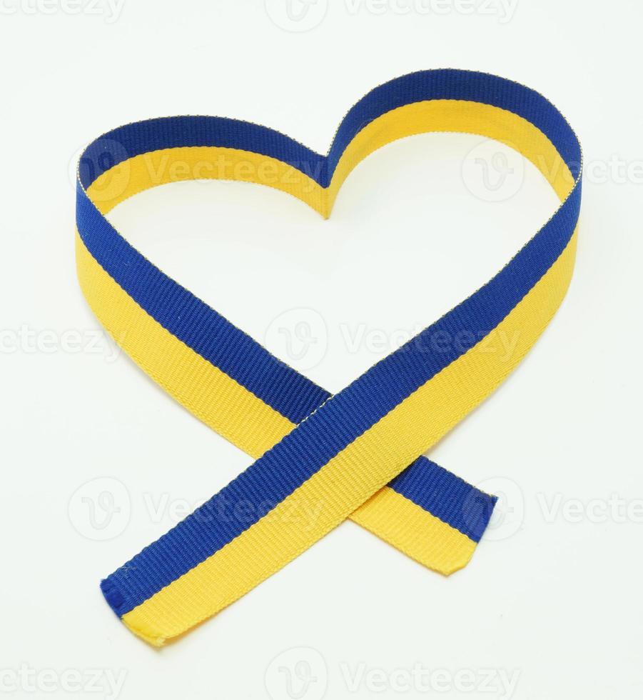 Ukrainian flag in the ribbon of heart photo