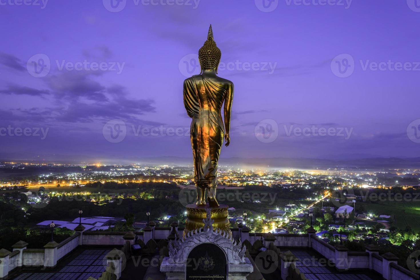 Golden buddha statue in Khao Noi temple, Nan Province, Thailand photo