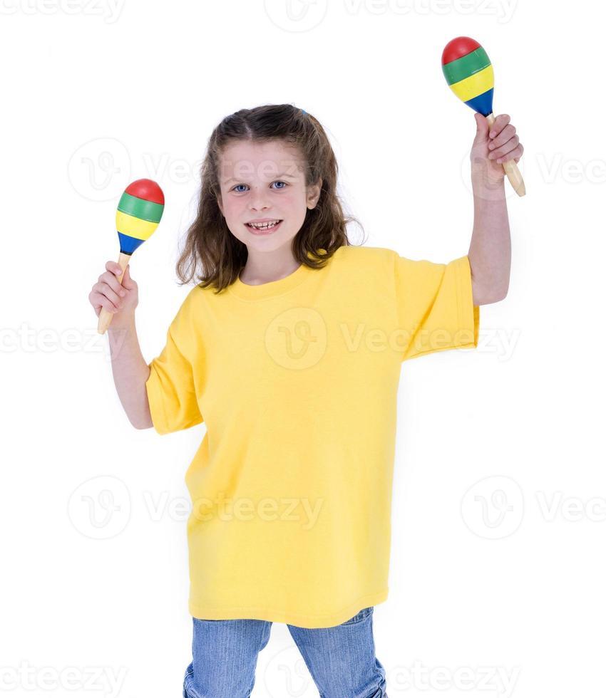School Girl playing maracas photo