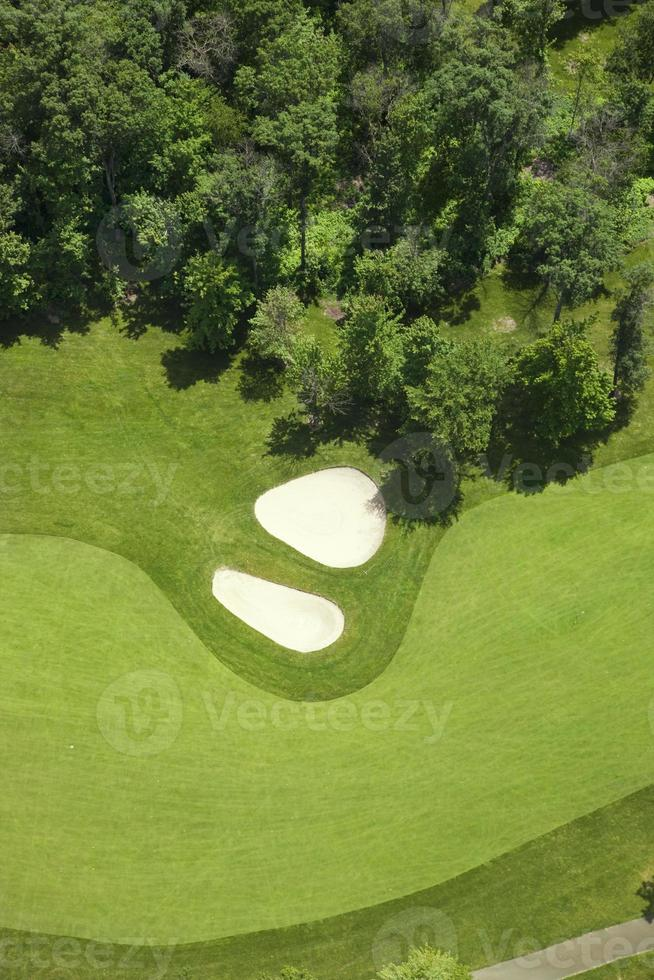 Aerial view of golf fairway and bunkers photo