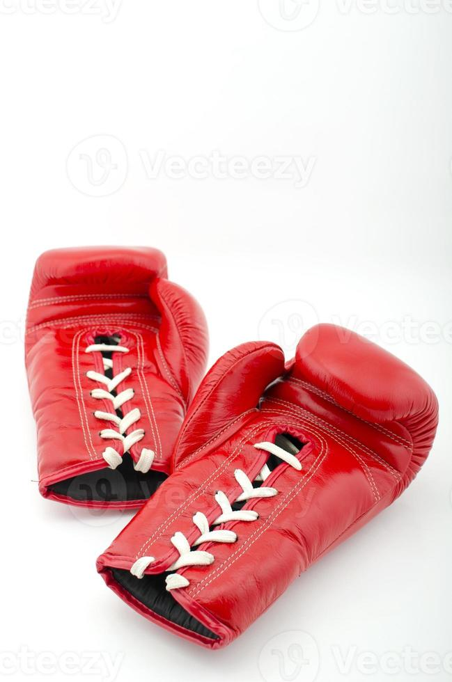 Red boxing gloves isolated on white photo