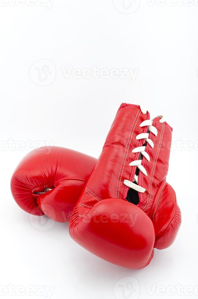 Red boxing gloves on white background photo