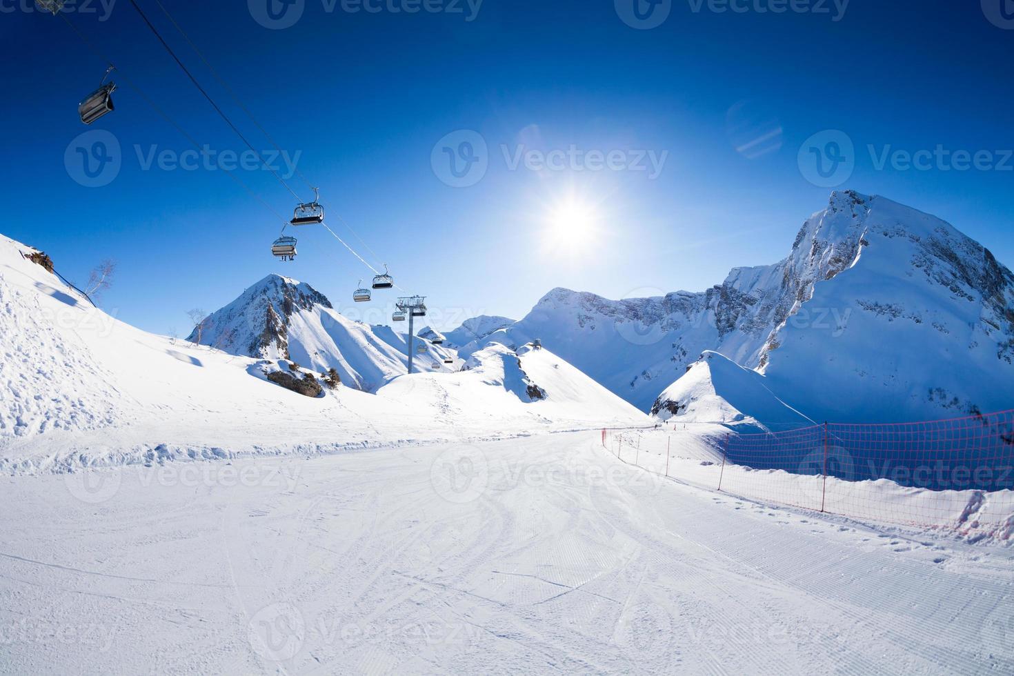Ski piste panorama with ropeway chair lift photo