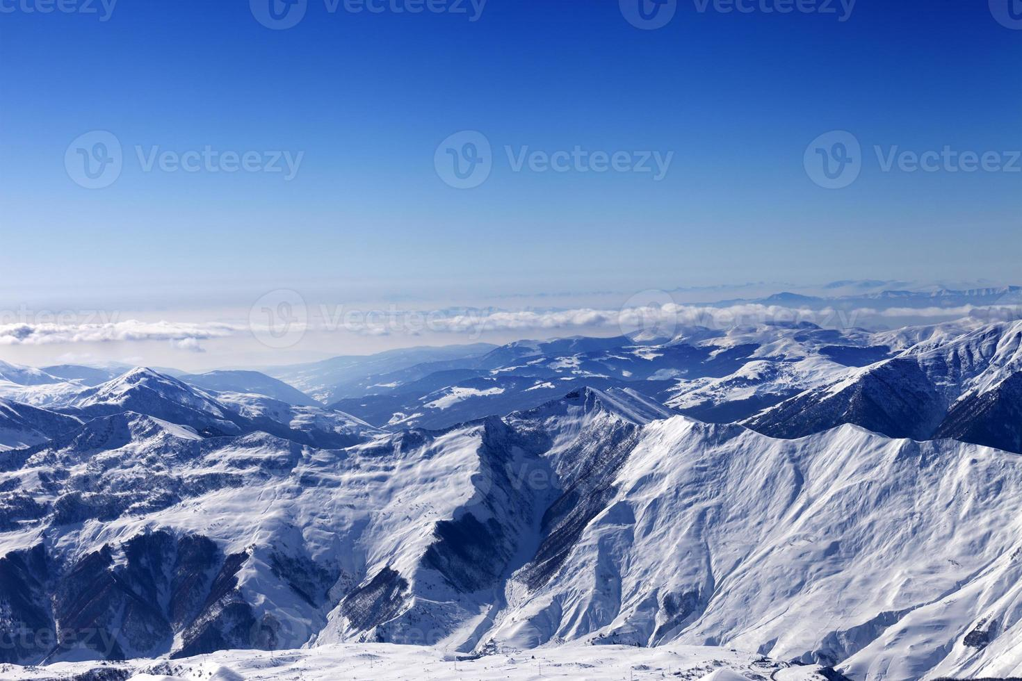 Winter snowy mountains in sun day photo