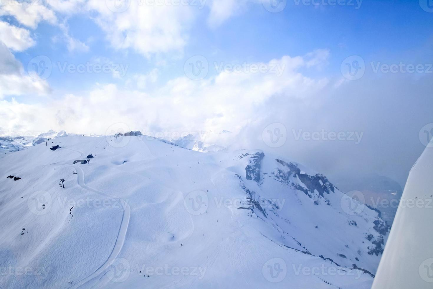 Unique airplane aerial view of central Swiss Alps ski resort photo