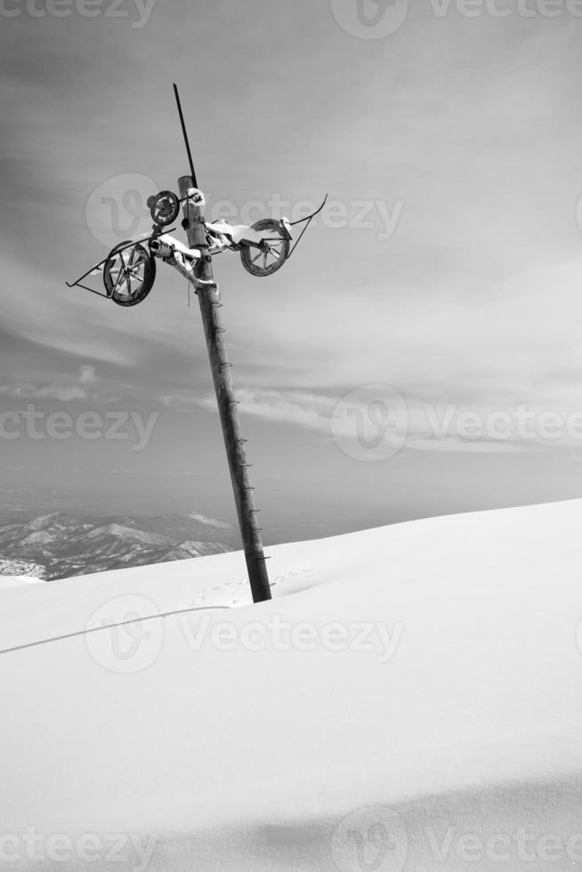 Abandoned skilift pillar photo