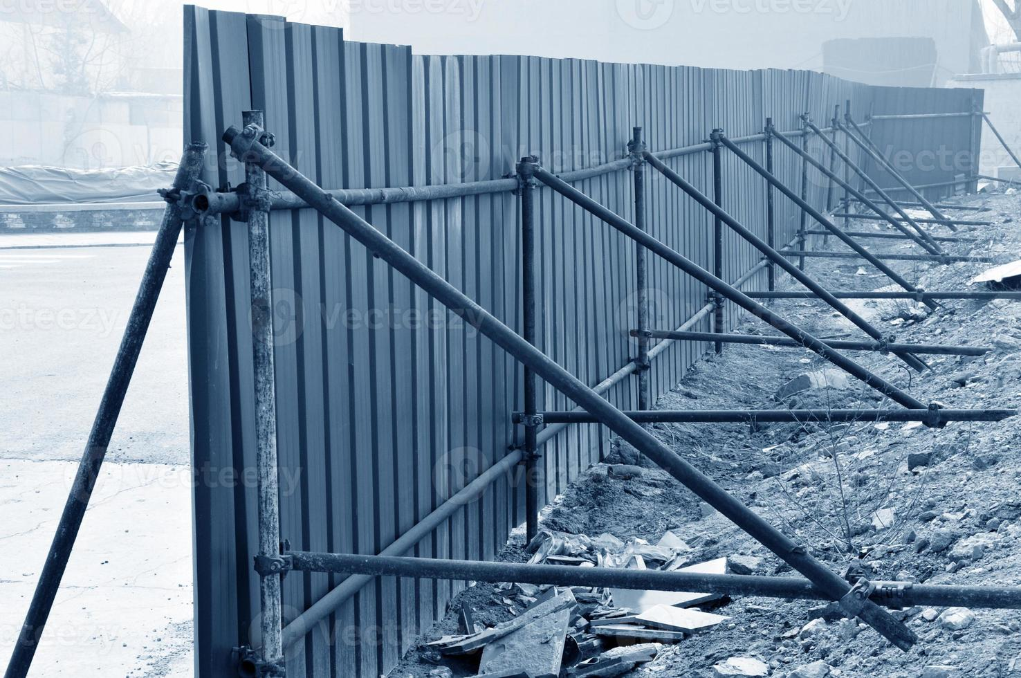 Simple fence, in the construction site photo