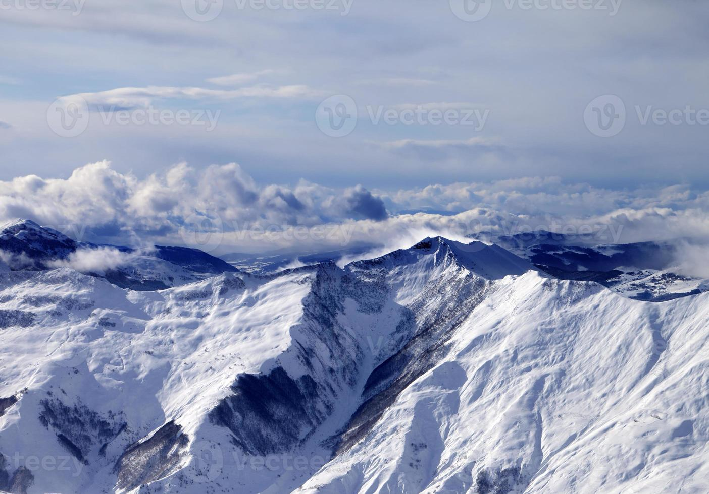 Winter mountains in mist at windy day photo