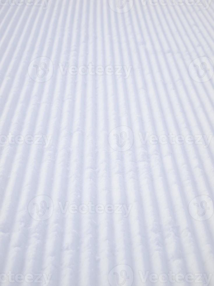 Tracks of snow compaction vehicle photo