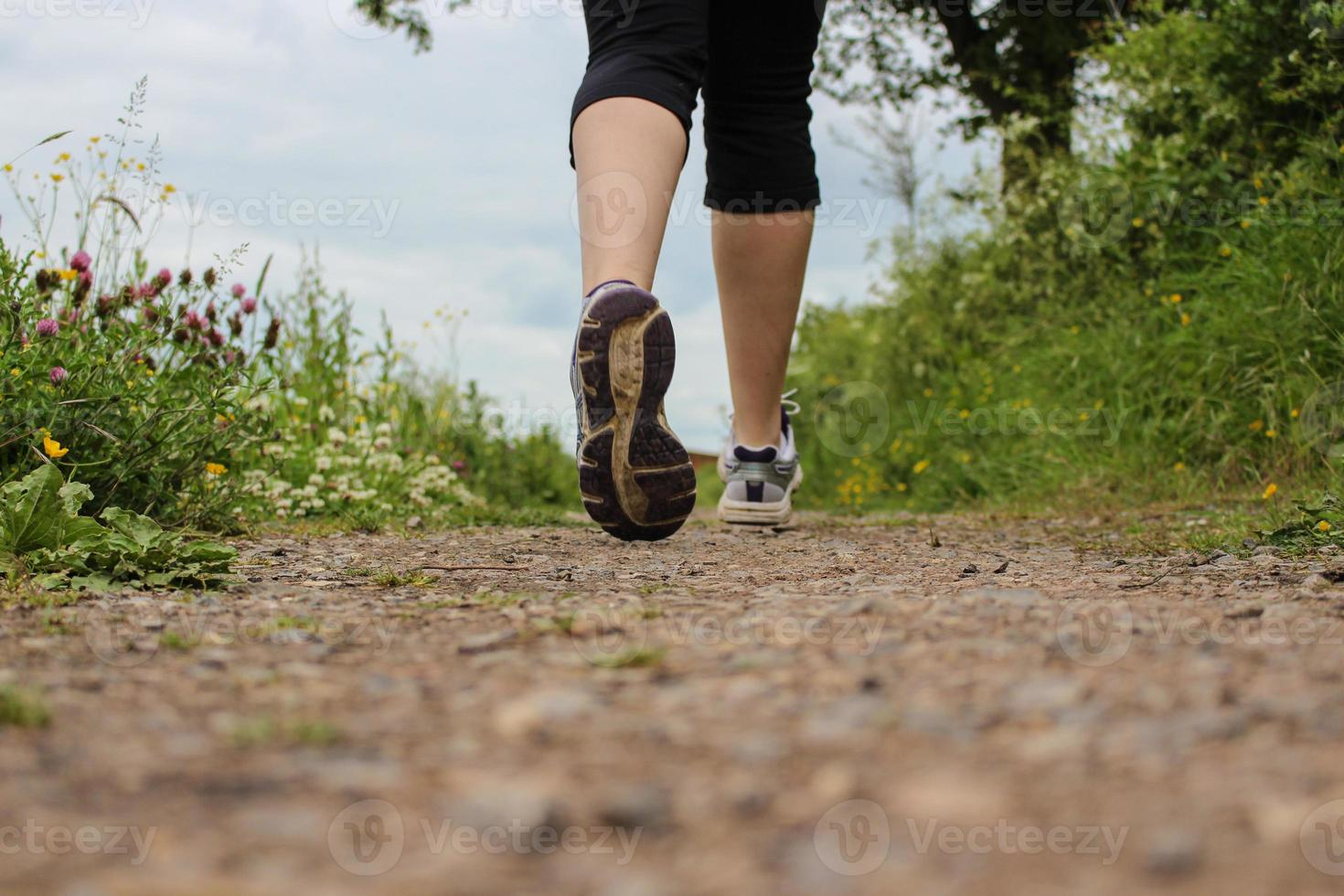 Runner on footpath photo
