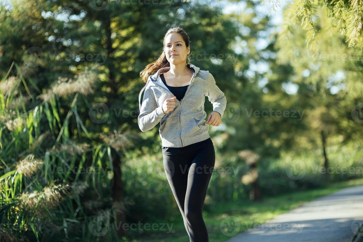 Woman running in park photo