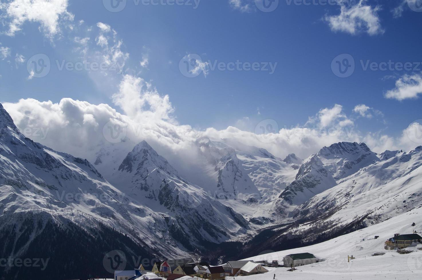 Cafe and hotels in high mountains. Ski resort. photo