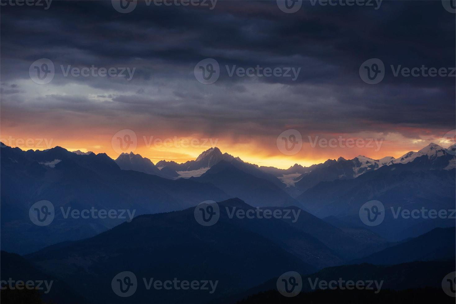 Autumn landscape and snow-capped mountain peaks. View of the mou photo