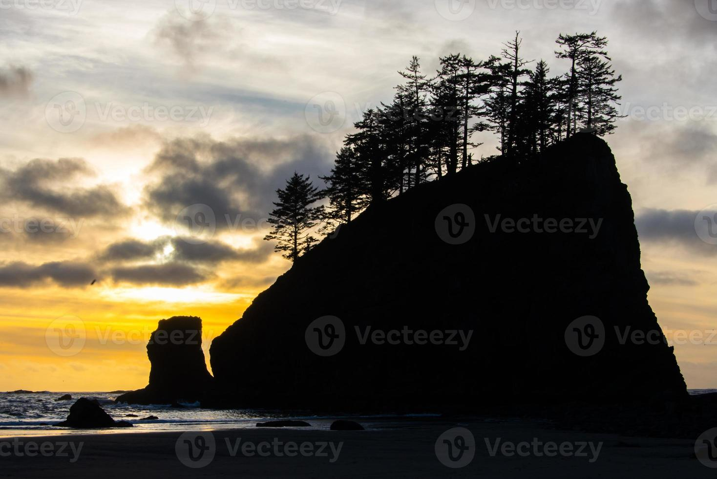 Silhouette Sea stack at sunset photo