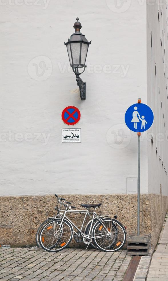 Bicycle standing on a street near the building photo