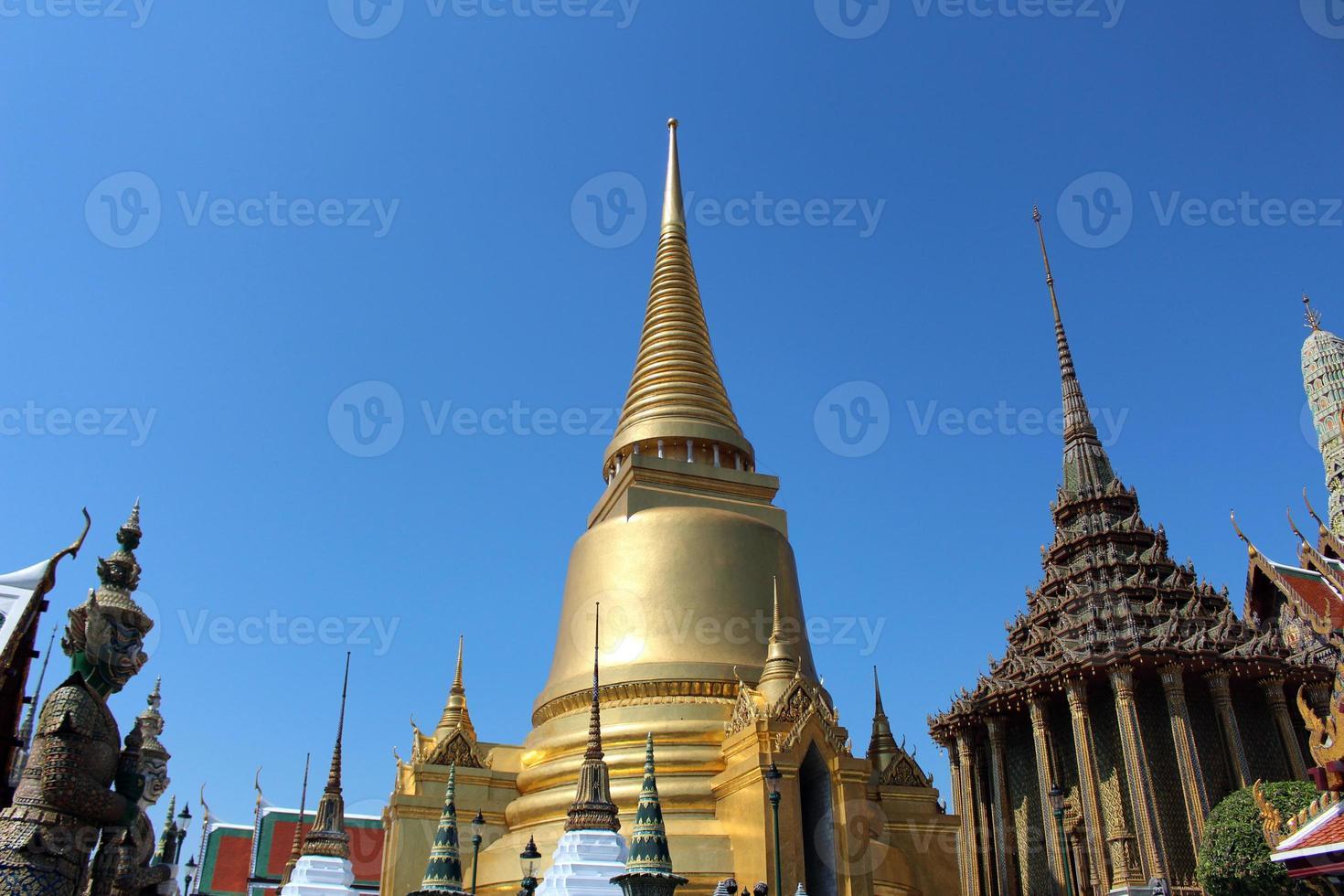 Golden pagoda in the Emerald Buddha Temple photo