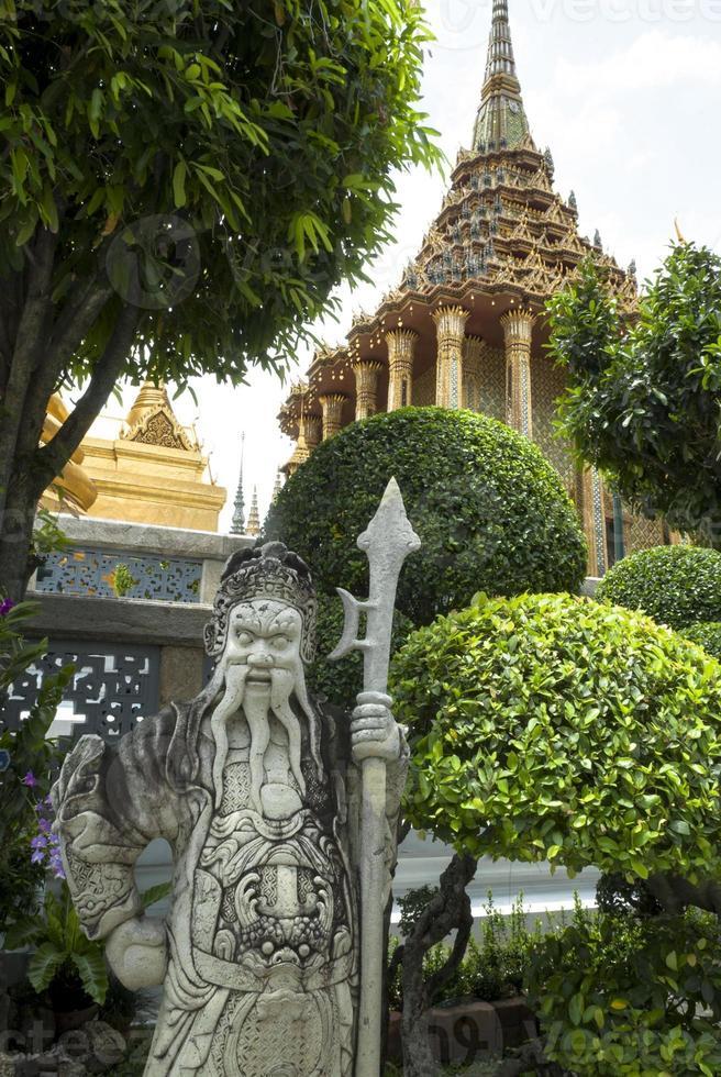 Wat Phra Kaew statue stone Bangkok Thailand photo