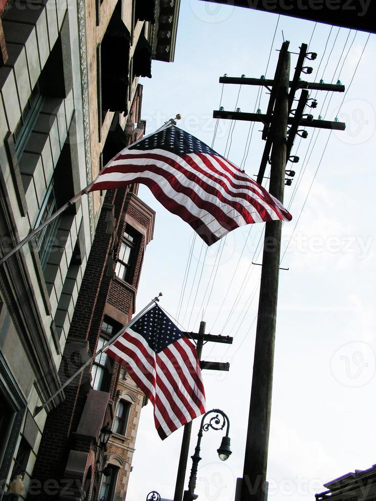 american flags hanging from a building photo