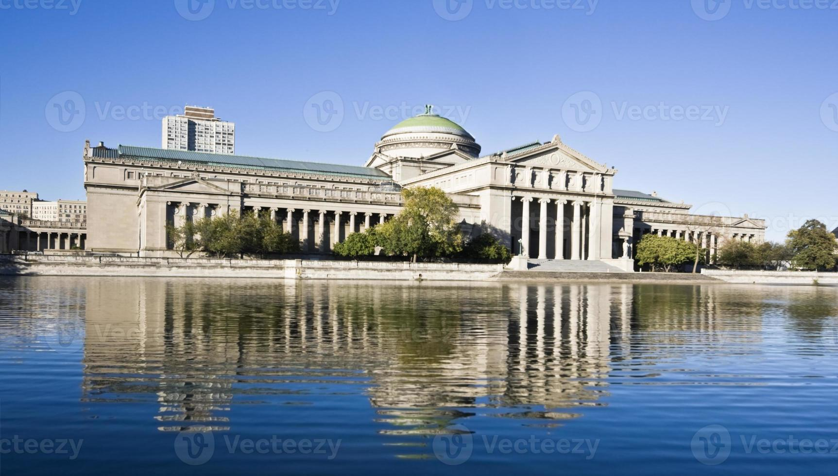 Museum of science and industry in front of pond photo