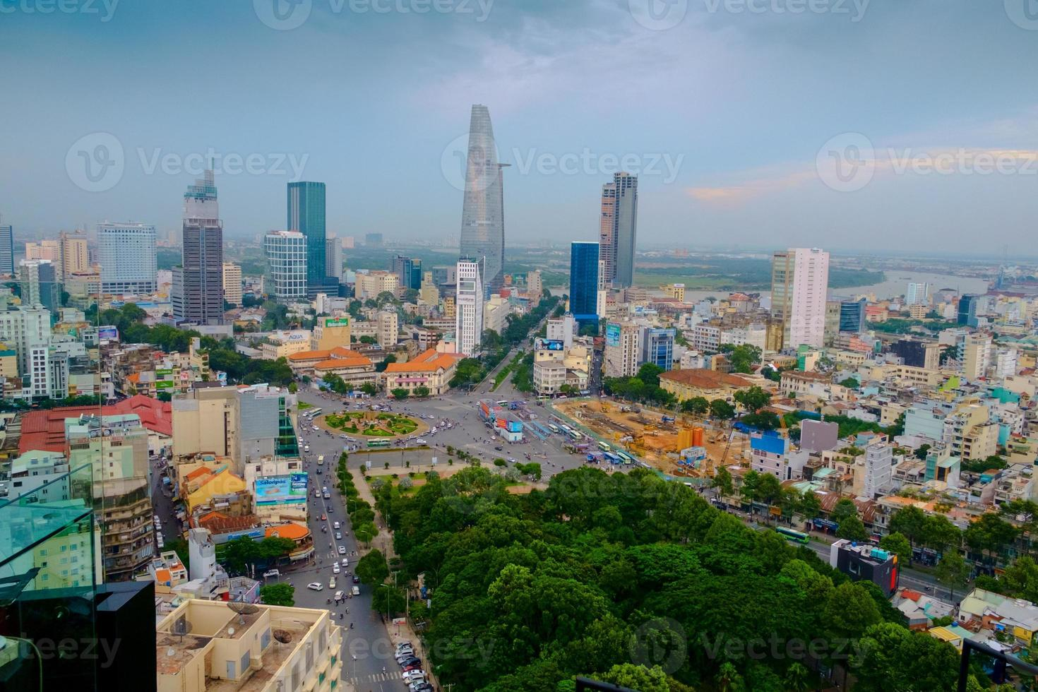 Aerial view of Ho Chi Minh City against blue sky photo