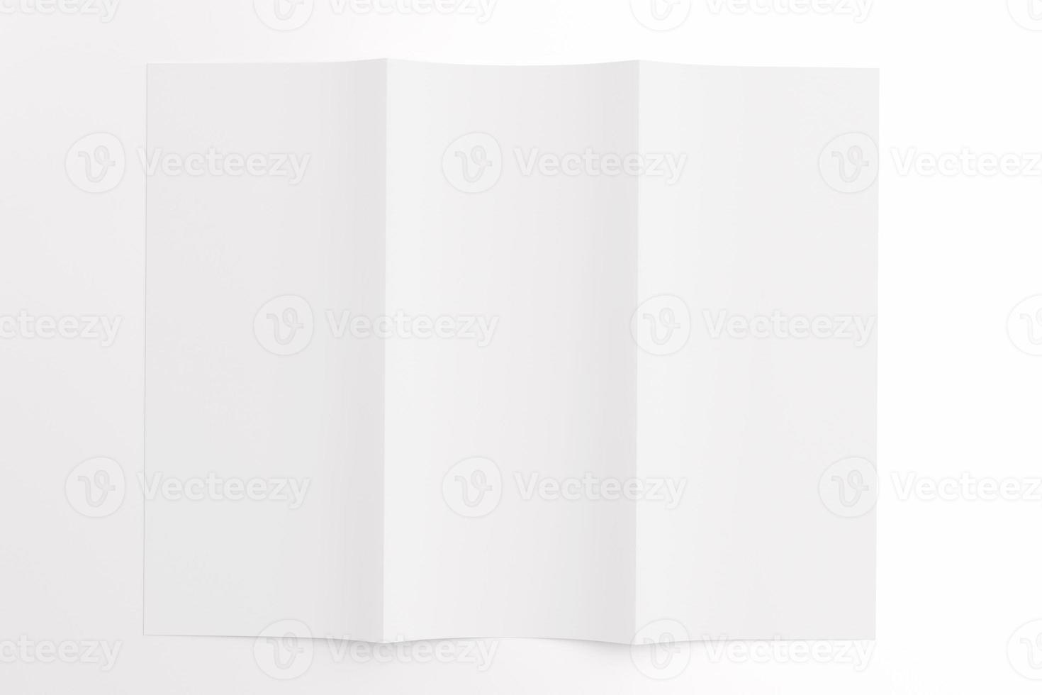 Blank tri fold brochure isolated on white photo