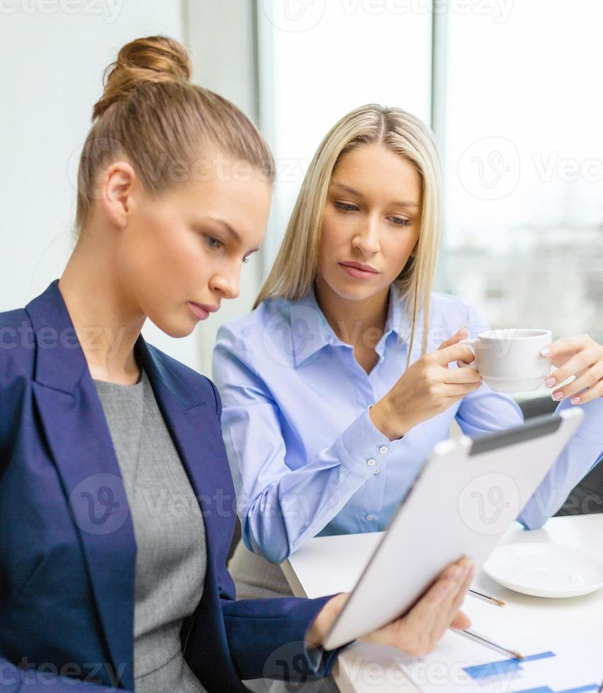 business team with tablet pc having discussion photo