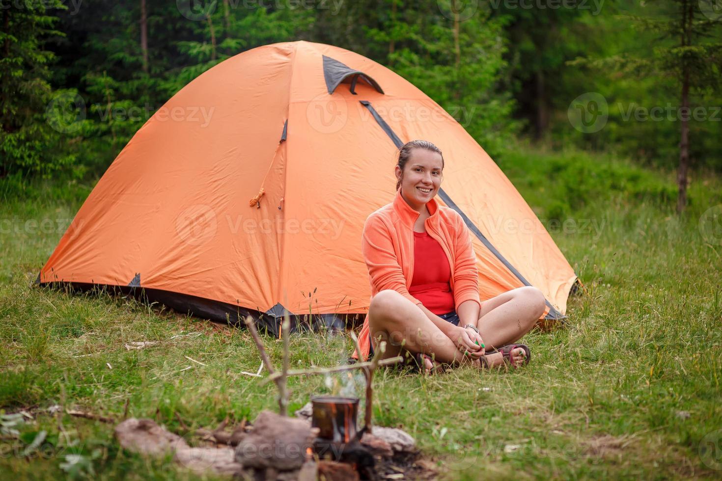 cheerful woman tourist tent photo
