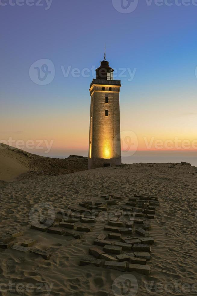 Lighthouse in the sunset photo